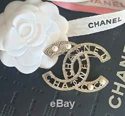 Brand new Chanel Classic CC Brooch Champagne Gold with Crystal and Pearl